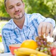 Stock Photo: MEnjoying Meal In Garden
