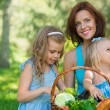 Mother with two daughters in the park — Foto de Stock