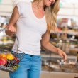 Casual woman grocery shopping — Stock Photo #29987133
