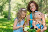 Mother with two daughters in the park — Stock Photo