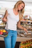 Casual woman grocery shopping — Stock Photo