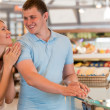 Young couple shopping at supermarket — Stock Photo #30392327