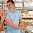 Stock Photo: Young couple shopping at supermarket