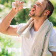 Sport fitness man. Young athletic man cooling himself — Stock Photo