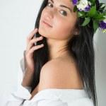 Beautiful woman wearing wreath of flowers — Stock Photo