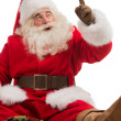 图库照片: SantClaus sitting and playing with toys