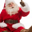 Stock Photo: SantClaus sitting and playing with toys