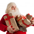 Portrait of Santa Claus with giftboxes looking away — Stock Photo