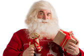 Portrait of Santa Claus with christmas deer decoration and gift — Stock Photo
