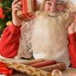 Santa Claus in his workshop making new toys — Stock Photo