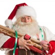 Stock Photo: Christmas SantClaus preparing gifts wrapping paper