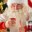 Portrait of happy Santa Claus at home eating cookies and drinkin — Stock Photo #31418161