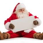 Santa claus gospodarstwa transparent — Zdjęcie stockowe