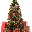 Foto de Stock  : Beautiful christmas tree with gift boxes and shopping bags