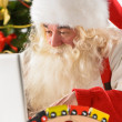 Real Santa Claus working on laptop with surprised face at home — Stock Photo