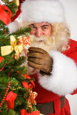 Real Santa Claus decorating Christmas tree — Stock Photo