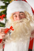 Santa Claus holding keys New year - new home concept — Stock Photo