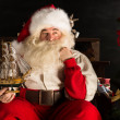 Santa Claus at home playing with new toys near Christmas Tree — Stock Photo #32362023