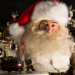 Santa Claus sitting at home near Christmas tree and waiting a ca — Foto Stock