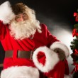 Santa Claus looking tired after delivering all gifts to children — Stock Photo