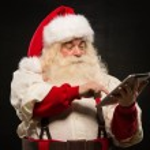 Santa Claus using tablet computer — Stock Photo #32364675