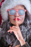 Woman wearing Santa Claus hat and sunglasses — Stock Photo