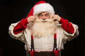 Photo of happy Santa Claus touching mustache — Stock Photo