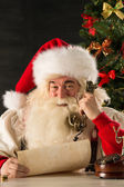 Santa Claus calling with vintage phone — Stock Photo