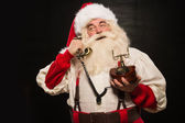 Portrait of happy Santa Claus calling phone — Foto Stock