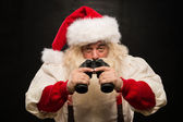 Noel baba ile dürbün — Stok fotoğraf