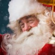 Santa Claus is holding a shining lantern while sneaking to his home — Stock Photo #32857487