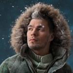 Handsome man in winter snow — Stock Photo #32857523