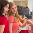 Two young women shopping in mall — Stock Photo