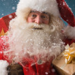 Santa Claus with his sack of presents — Stockfoto