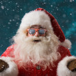 Santa Claus wearing sunglasses dancing outdoors at North Pole — Foto Stock