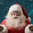 Santa Claus wearing sunglasses dancing outdoors at North Pole — Stok fotoğraf