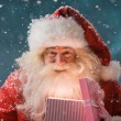 Стоковое фото: Happy SantClaus opening his Christmas gift at North Pole