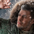 Handsome man in winter snow — Stock Photo