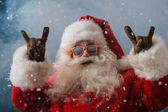 Santa Claus wearing sunglasses dancing outdoors at North Pole — Stock Photo
