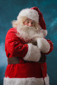 Santa Claus standing outdoors at north pole — Stock Photo