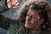 Handsome man in winter snow — Stock Photo