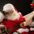 Santa Claus reading letter — Foto de Stock