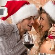 Couple wearing Santa hats — Stock Photo #33878933