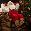 Santa Claus while relaxing at home — Stock Photo