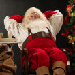 Santa Claus relaxing at home — Stock Photo #33879847