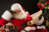 Santa Claus reading letter — Stock Photo