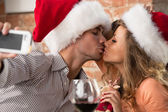 couple wearing Santa hats  — Stock Photo