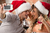 couple wearing Santa hats — Stock Photo