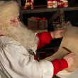 Santa Claus sitting at home — 图库照片