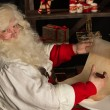 Stock Photo: Santa Claus sitting at home